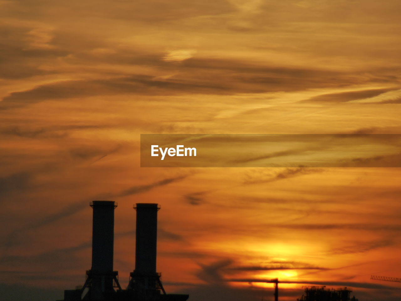 sunset, cloud - sky, orange color, sky, built structure, industry, architecture, no people, factory, building exterior, smoke stack, outdoors, beauty in nature, nature