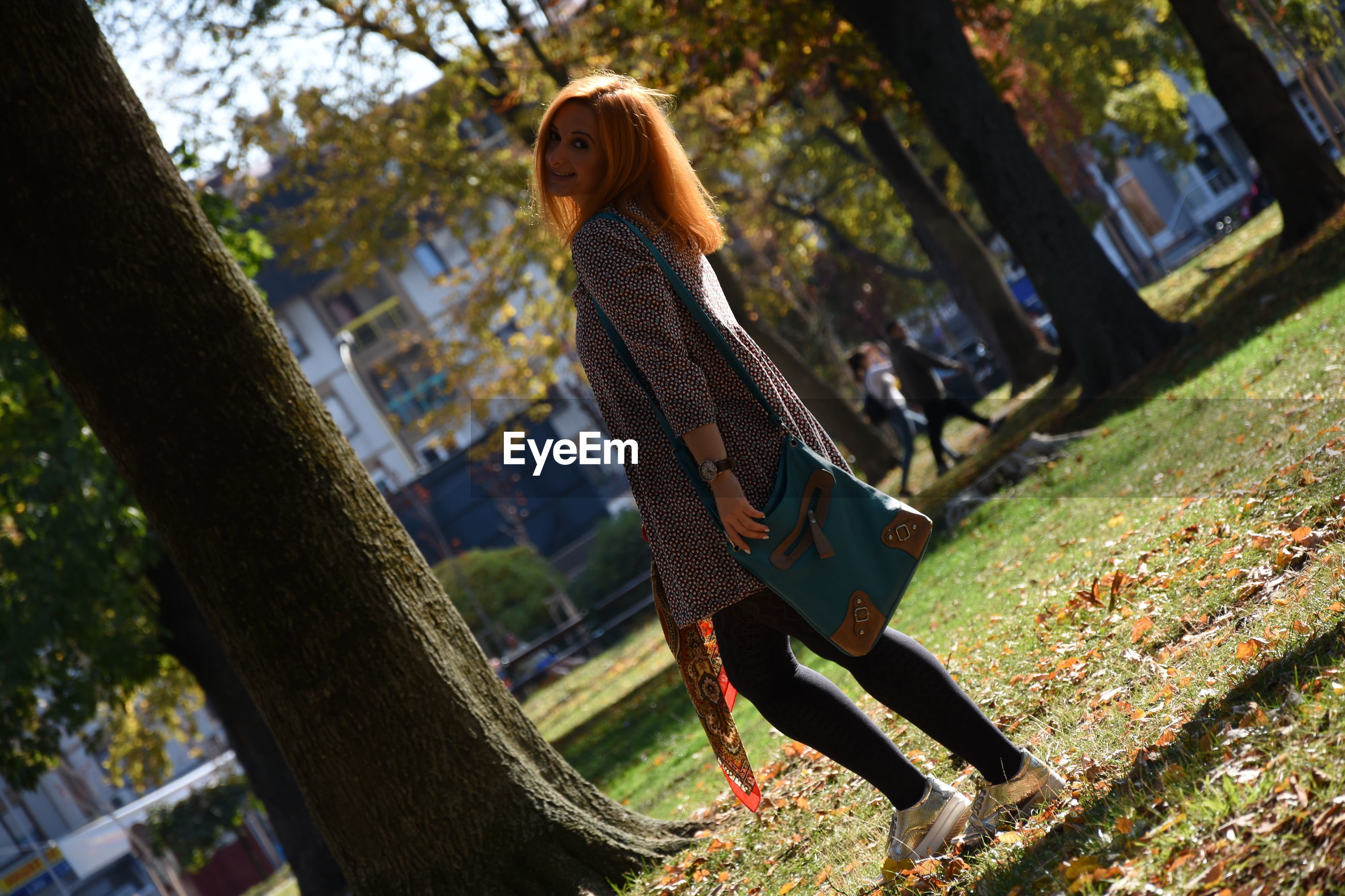 Side view of woman standing at park