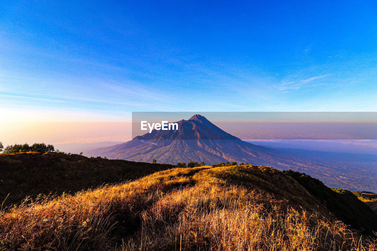 sky, mountain, beauty in nature, scenics - nature, tranquil scene, tranquility, landscape, non-urban scene, environment, land, volcano, no people, nature, blue, idyllic, travel destinations, plant, mountain peak, tourism, cloud - sky, outdoors, snowcapped mountain, volcanic crater