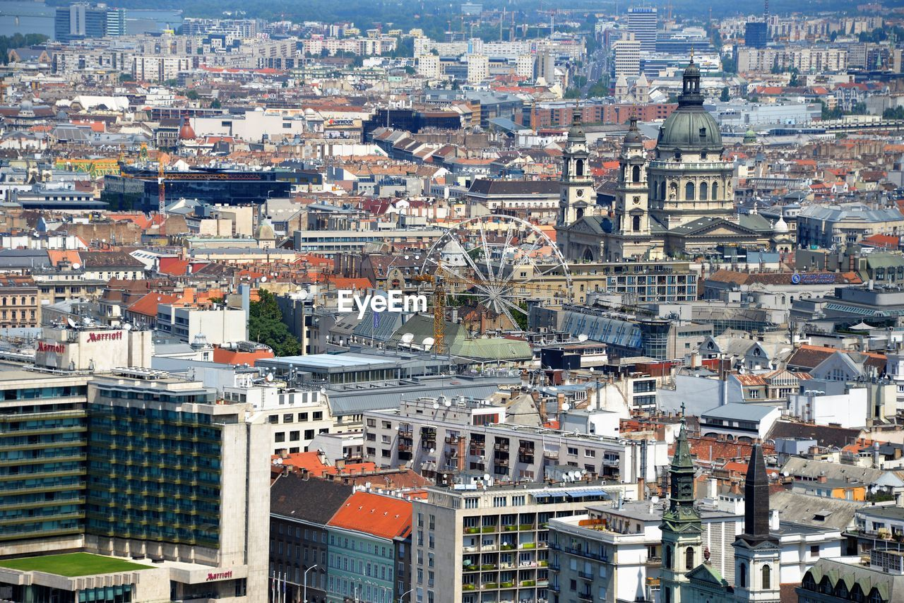 building exterior, architecture, city, built structure, building, cityscape, residential district, crowded, crowd, high angle view, aerial view, day, nature, roof, outdoors, community, city life, town, office building exterior, settlement, townscape, urban sprawl