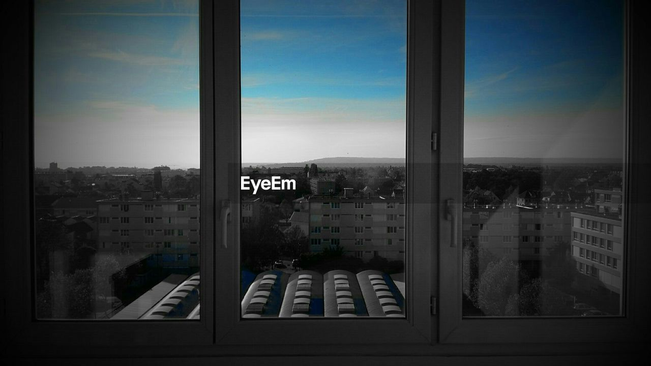 window, architecture, sky, building exterior, cityscape, built structure, no people, day, city, mountain, indoors, nature