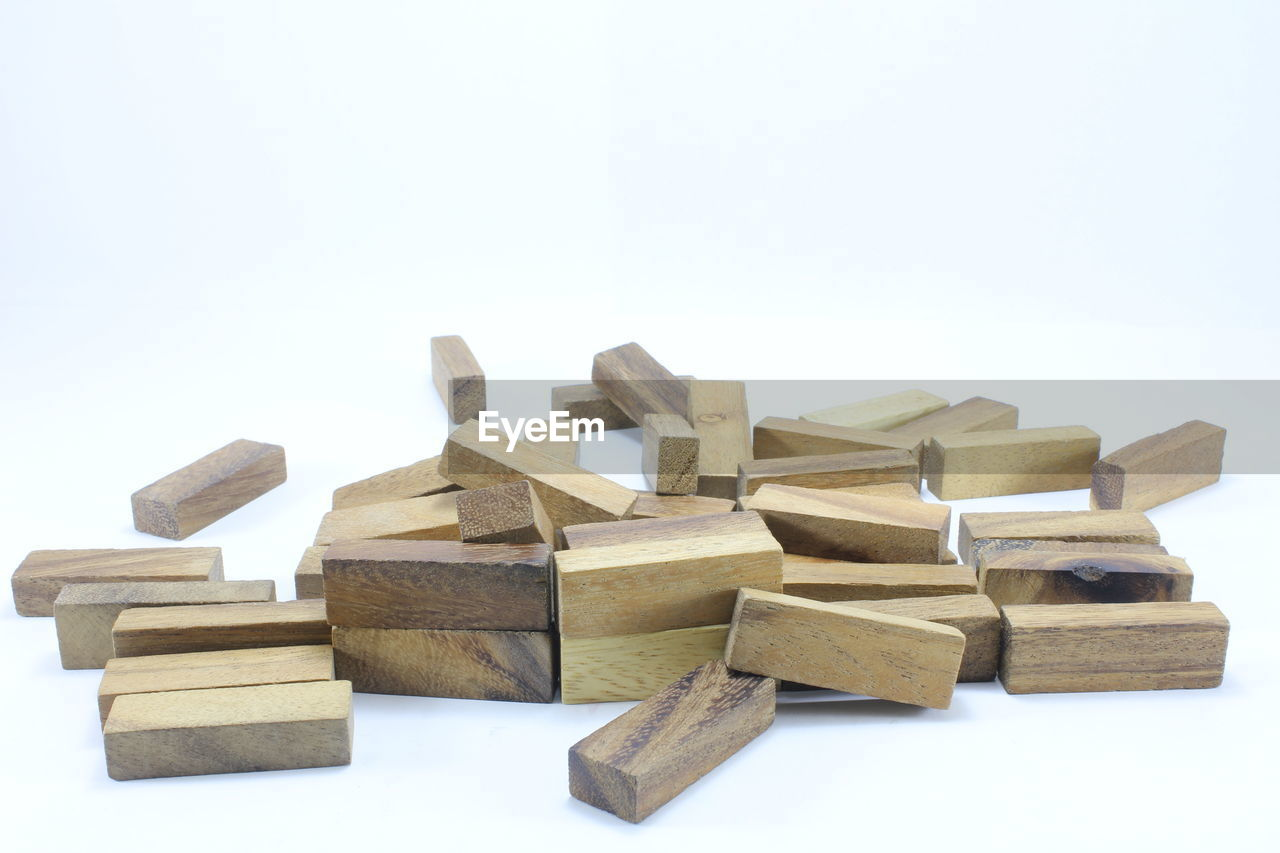 Close-up of wooden dominoes against white background