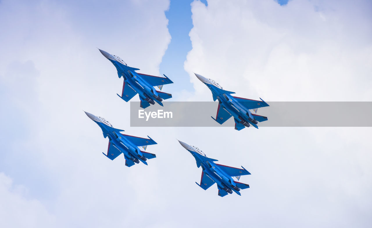 blue, sky, flying, cloud - sky, airshow, teamwork, celebration, airplane, flag, low angle view, multi colored, military airplane, air vehicle, patriotism, fighter plane, day, no people, outdoors, vapor trail