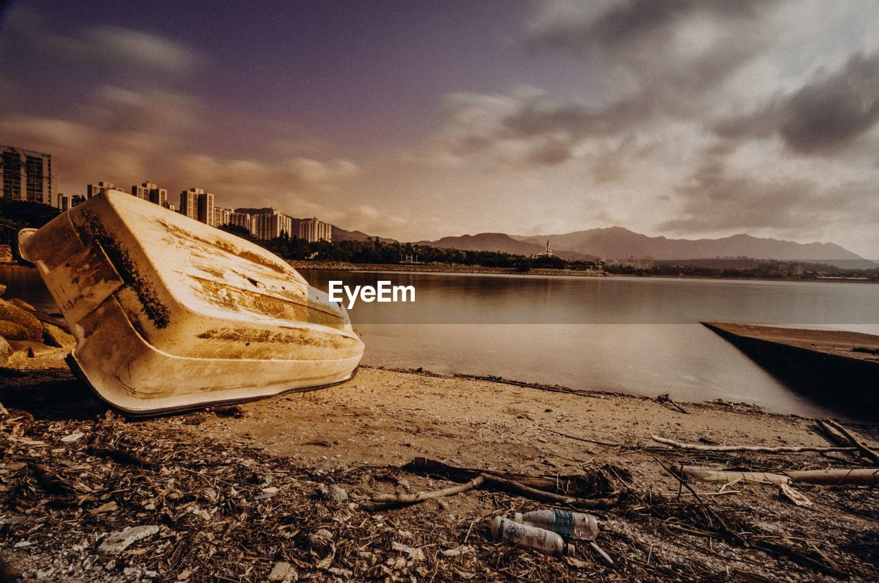 water, sky, cloud - sky, nautical vessel, nature, transportation, lake, mode of transportation, no people, beach, tranquility, abandoned, scenics - nature, tranquil scene, day, beauty in nature, mountain, outdoors, land