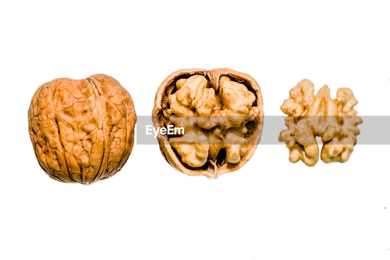studio shot, white background, food and drink, food, still life, indoors, close-up, cut out, healthy eating, nut, no people, wellbeing, freshness, nut - food, walnut, copy space, snack, high angle view, group of objects, brown, temptation