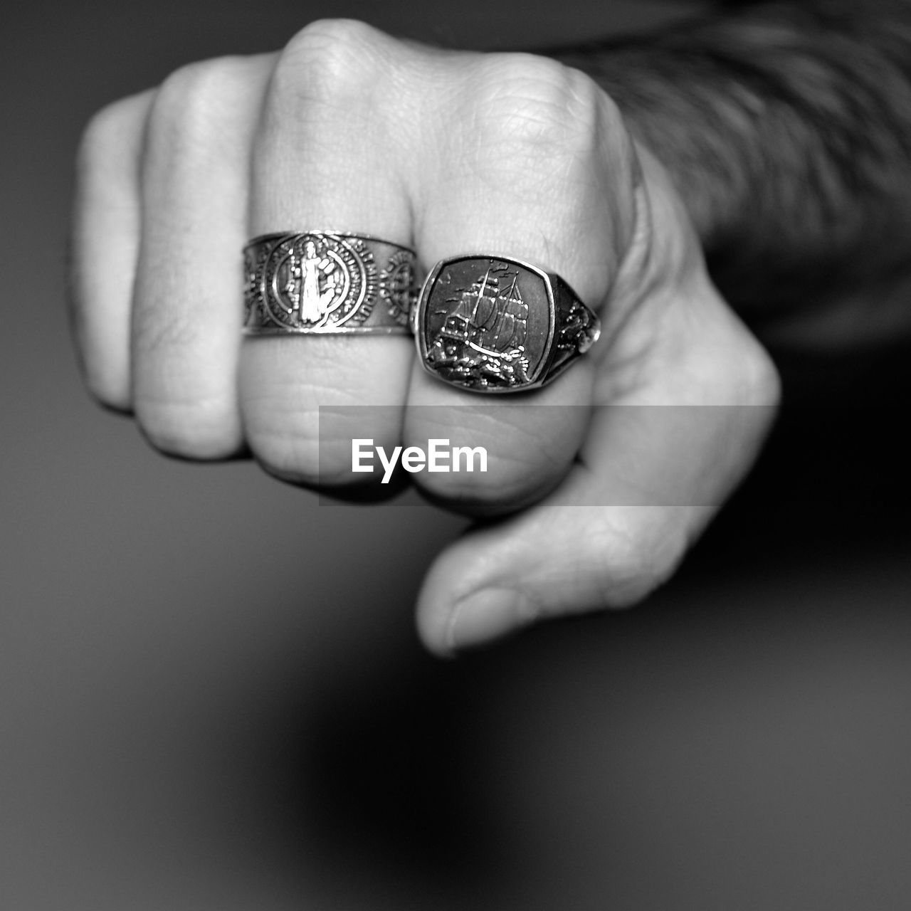 Cropped Image Of Hand Wearing Carved Rings
