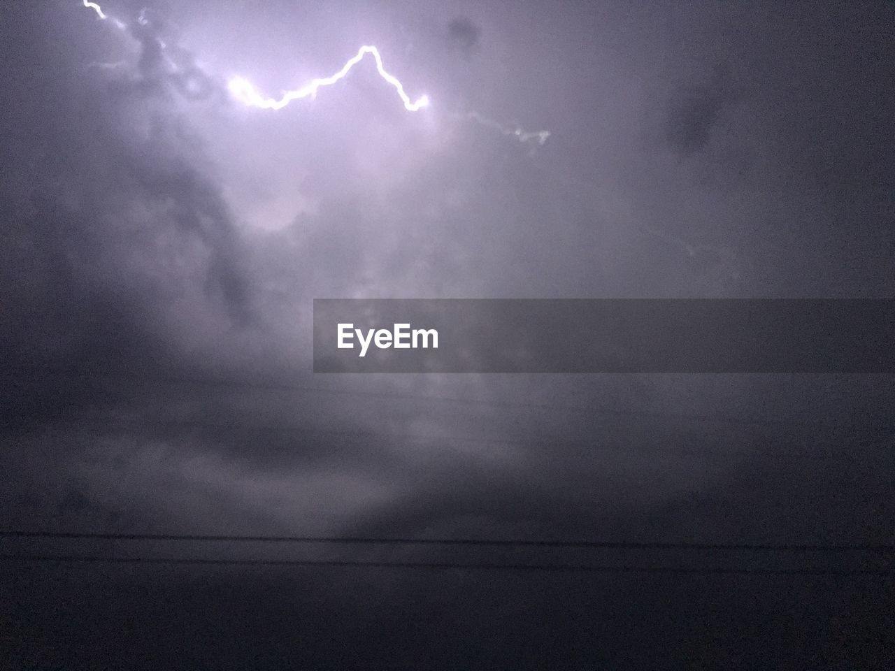 cloud - sky, sky, storm cloud, nature, weather, beauty in nature, lightning, no people, scenics, power in nature, storm, thunderstorm, outdoors, forked lightning, day