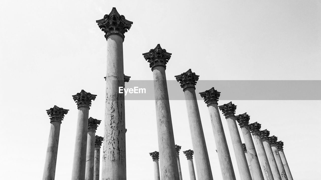 Low Angle View Of Columns Against Sky
