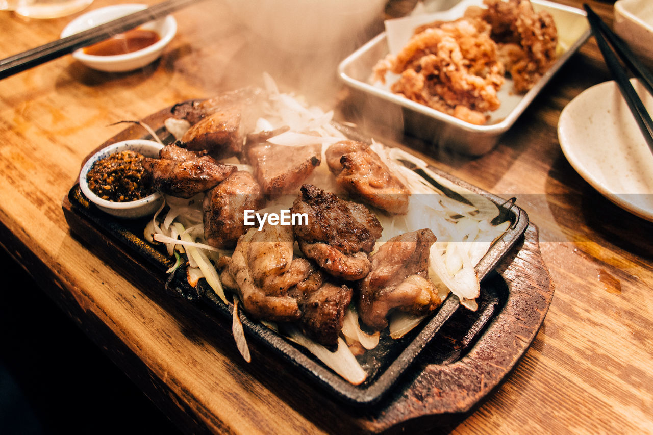 High Angle View Of Chicken Served In Tray At Table