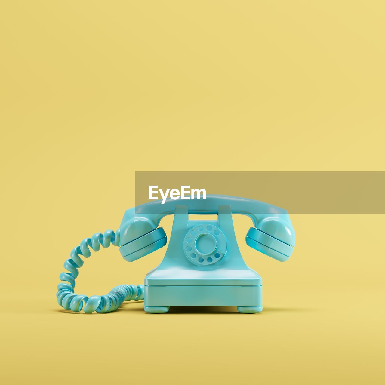 Close-up of telephone against yellow background