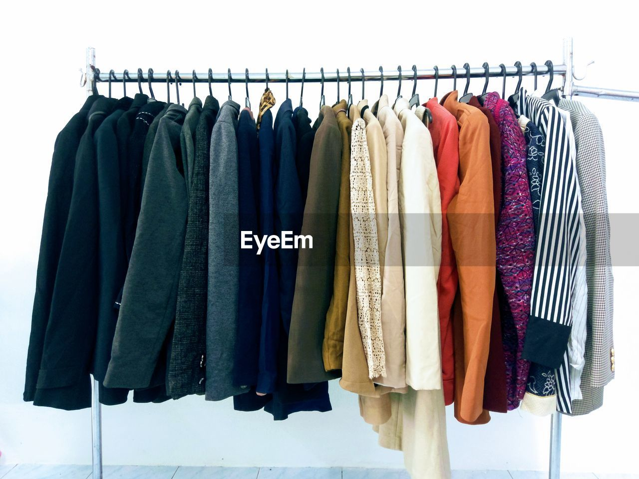 CLOTHES HANGING IN ROW