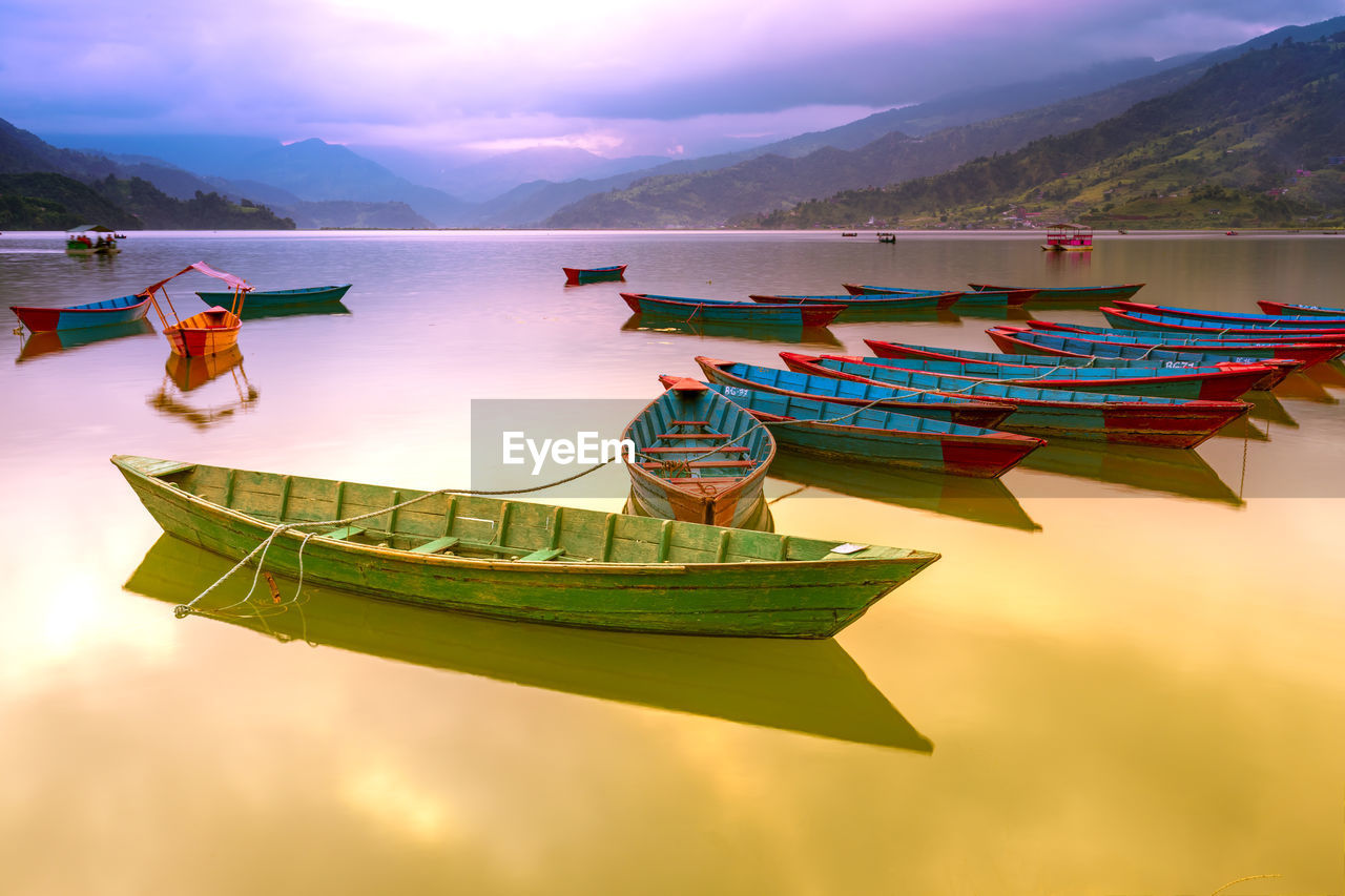 nautical vessel, water, sky, moored, transportation, beauty in nature, scenics - nature, mode of transportation, nature, cloud - sky, tranquil scene, tranquility, no people, sunset, mountain, lake, waterfront, idyllic, outdoors, rowboat, fishing boat