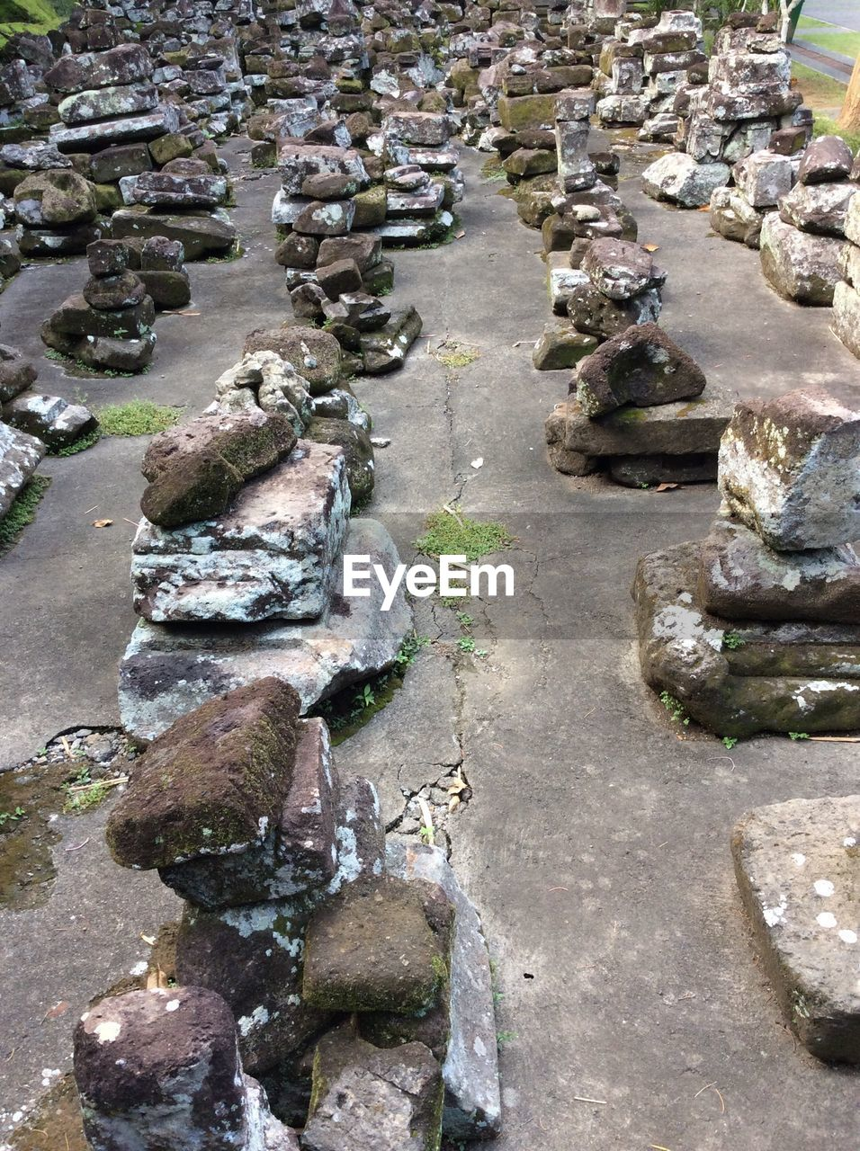 High angle view of stones stacked outdoors