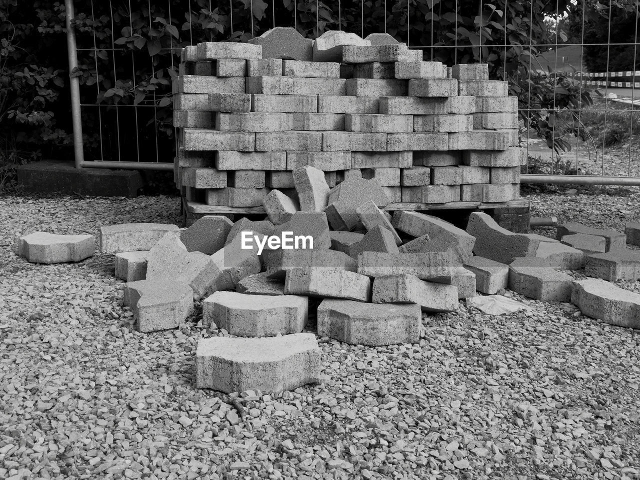 stack, large group of objects, day, abundance, no people, nature, solid, outdoors, construction site, construction industry, block, architecture, land, stone - object, brick, tree, built structure, industry, field, wood - material, concrete