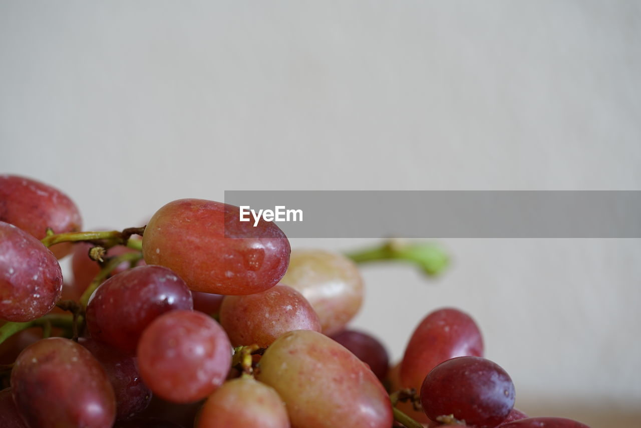 fruit, food, healthy eating, food and drink, wellbeing, freshness, still life, close-up, red, indoors, no people, grape, selective focus, large group of objects, red grape, copy space, table, ripe, focus on foreground, choice, temptation