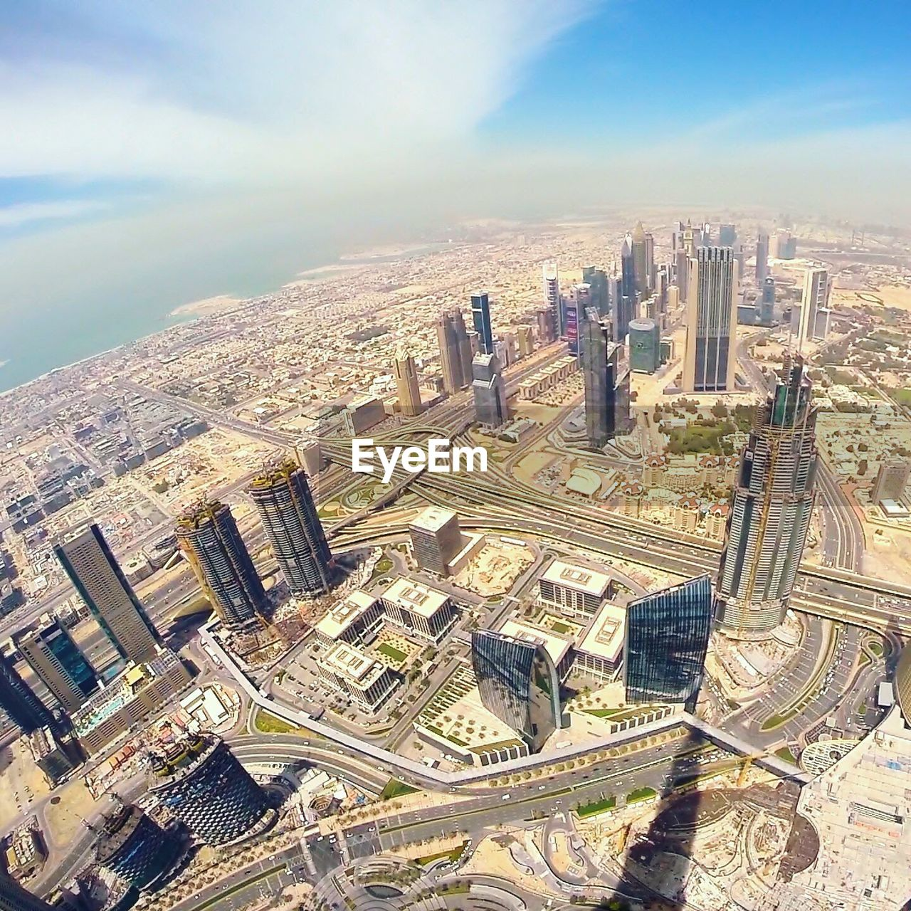 architecture, cityscape, building exterior, skyscraper, built structure, city, aerial view, sky, travel destinations, high angle view, sunlight, modern, no people, day, outdoors, downtown district, growth, road, urban skyline