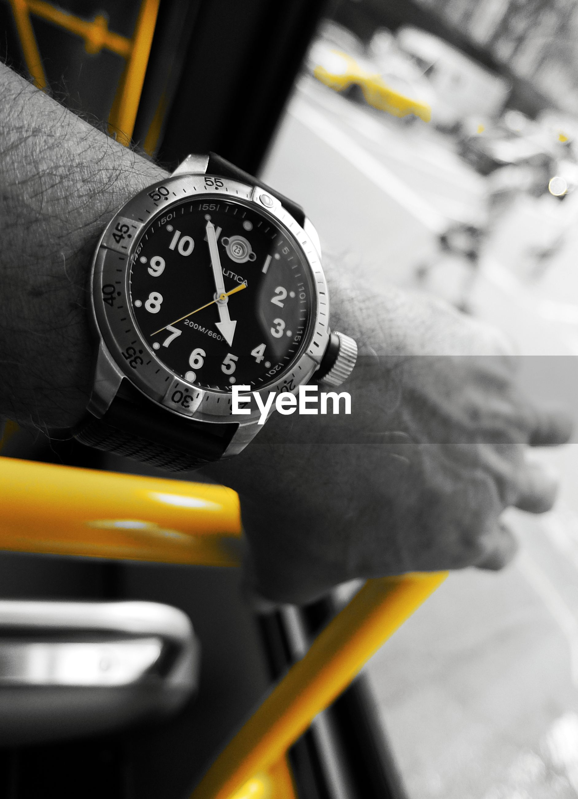 land vehicle, transportation, car, human hand, mode of transport, close-up, focus on foreground, speedometer, day, wristwatch, outdoors, technology, time, one person, clock face