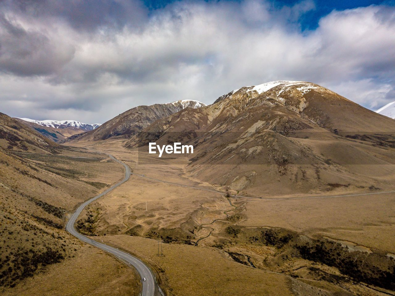 landscape, sky, mountain, cloud - sky, beauty in nature, nature, road, day, outdoors, scenics, curve, mountain range, no people