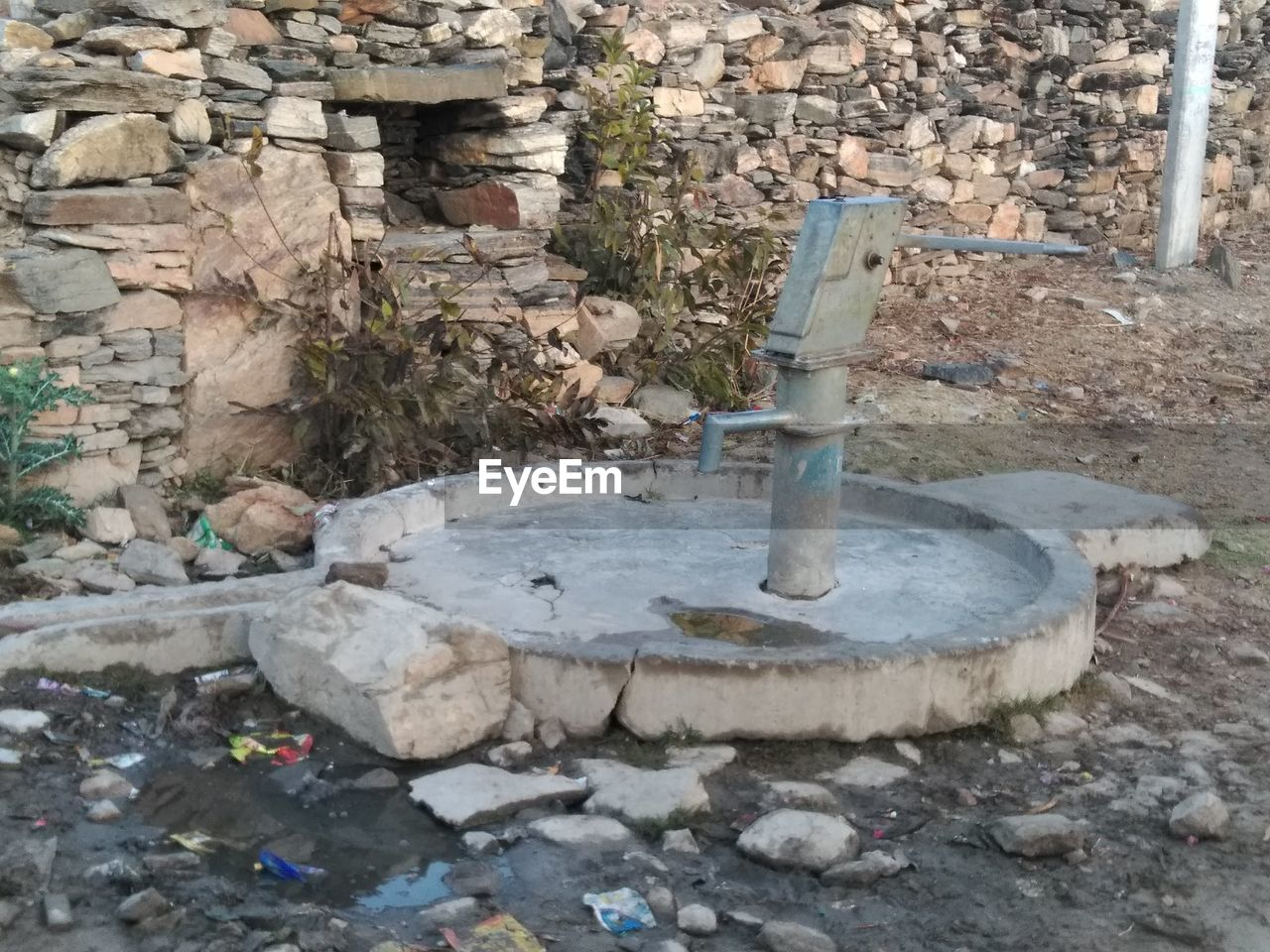 stone - object, stone material, rock - object, work tool, old-fashioned, no people, drinking fountain, outdoors, day