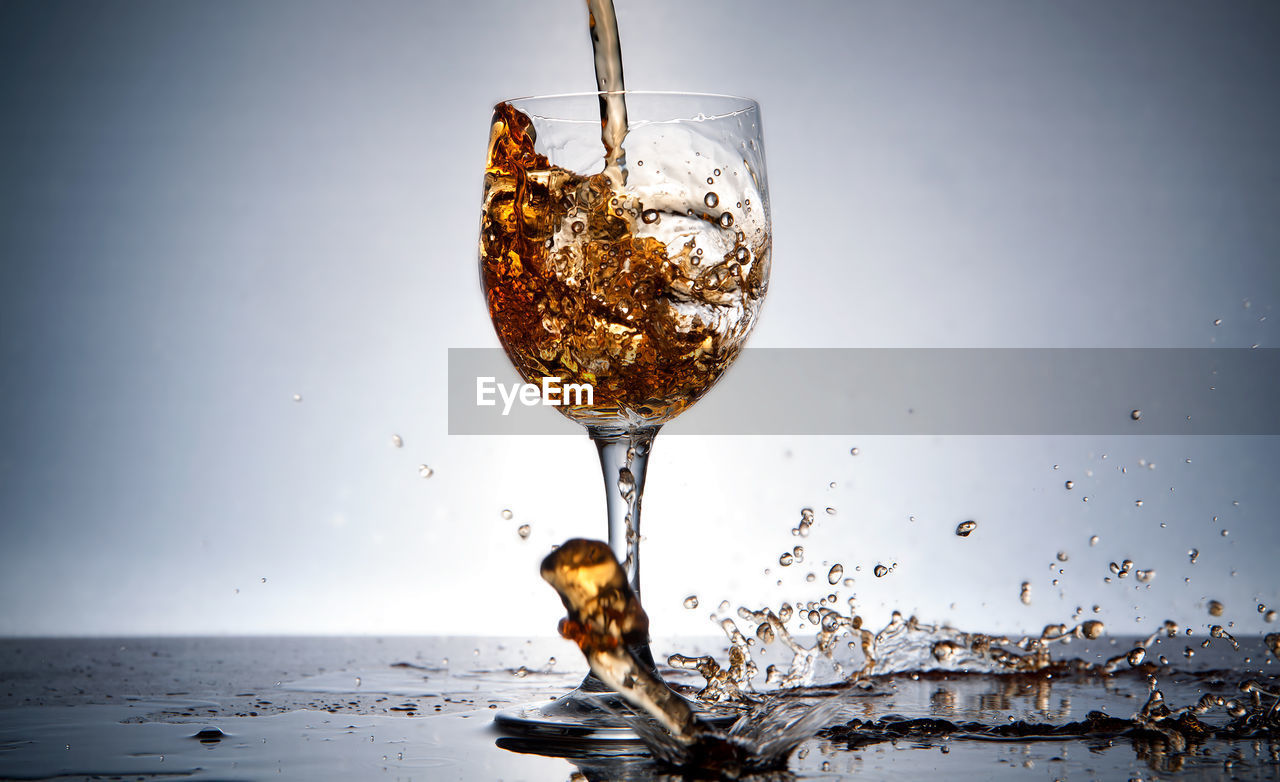 Close-Up Of Pouring Wine Into Glass