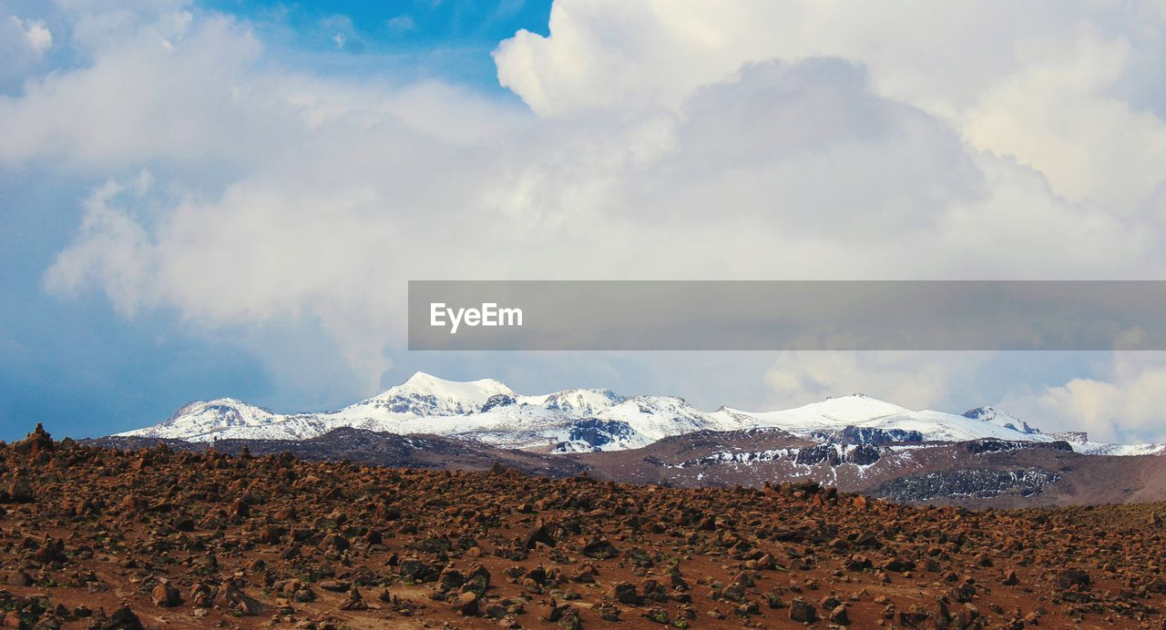 cloud - sky, sky, mountain, beauty in nature, scenics - nature, landscape, environment, nature, day, snow, tranquility, tranquil scene, non-urban scene, no people, winter, cold temperature, land, outdoors, snowcapped mountain, mountain peak, arid climate