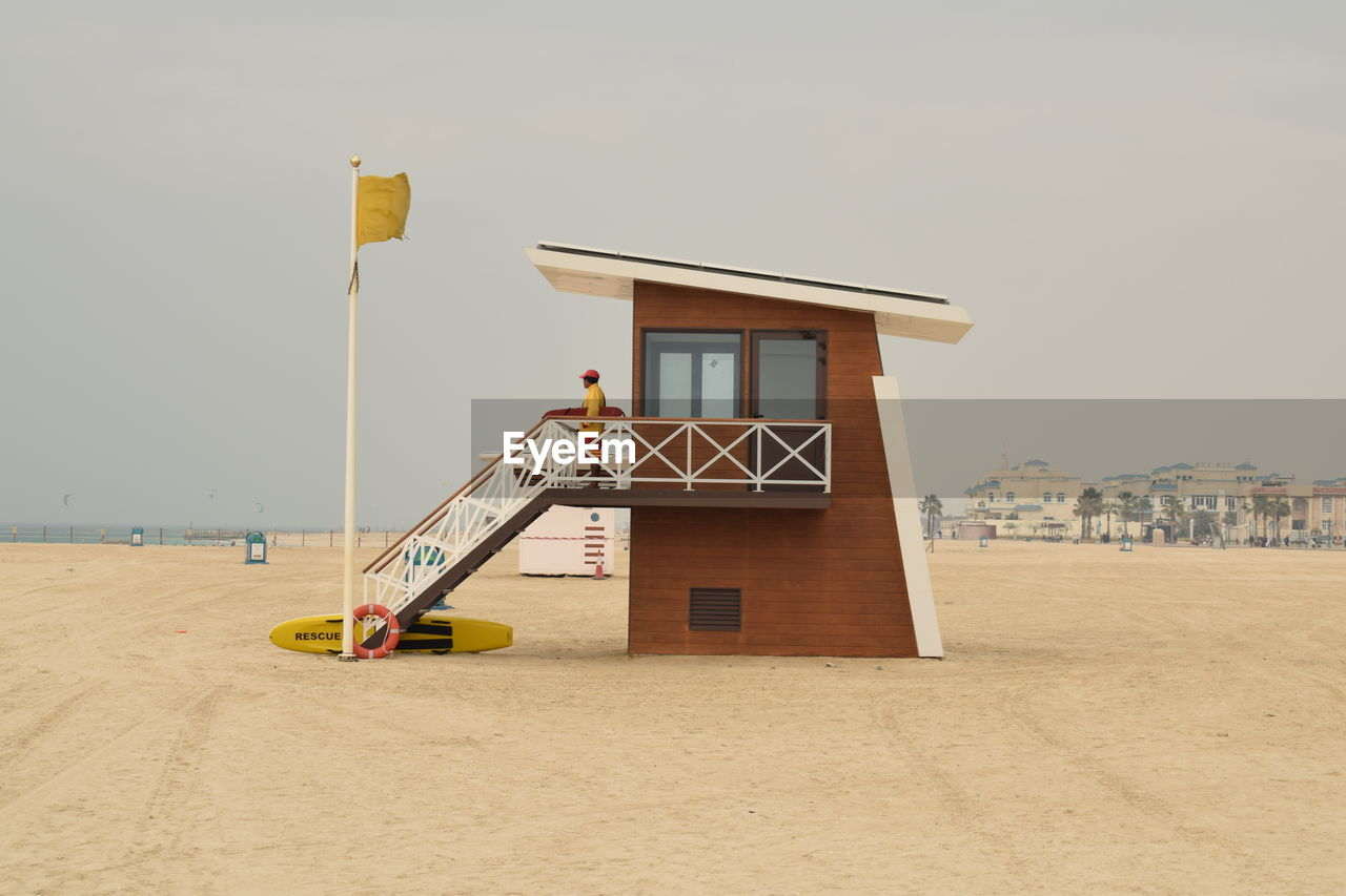 built structure, architecture, sand, beach, building exterior, lifeguard hut, day, no people, outdoors, sea, nature, sky