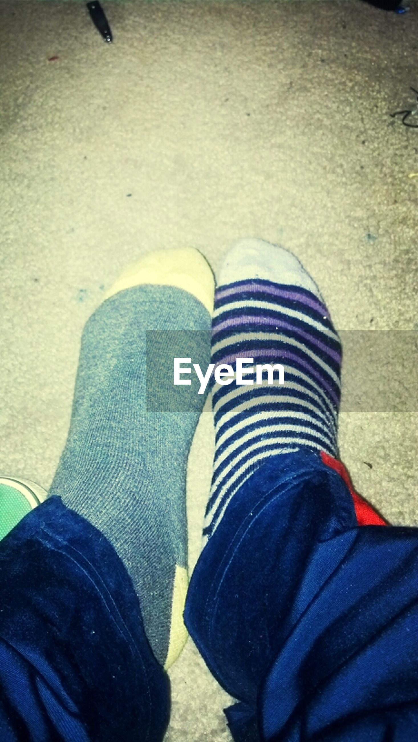 low section, person, shoe, personal perspective, lifestyles, jeans, men, leisure activity, standing, human foot, casual clothing, footwear, high angle view, unrecognizable person, blue