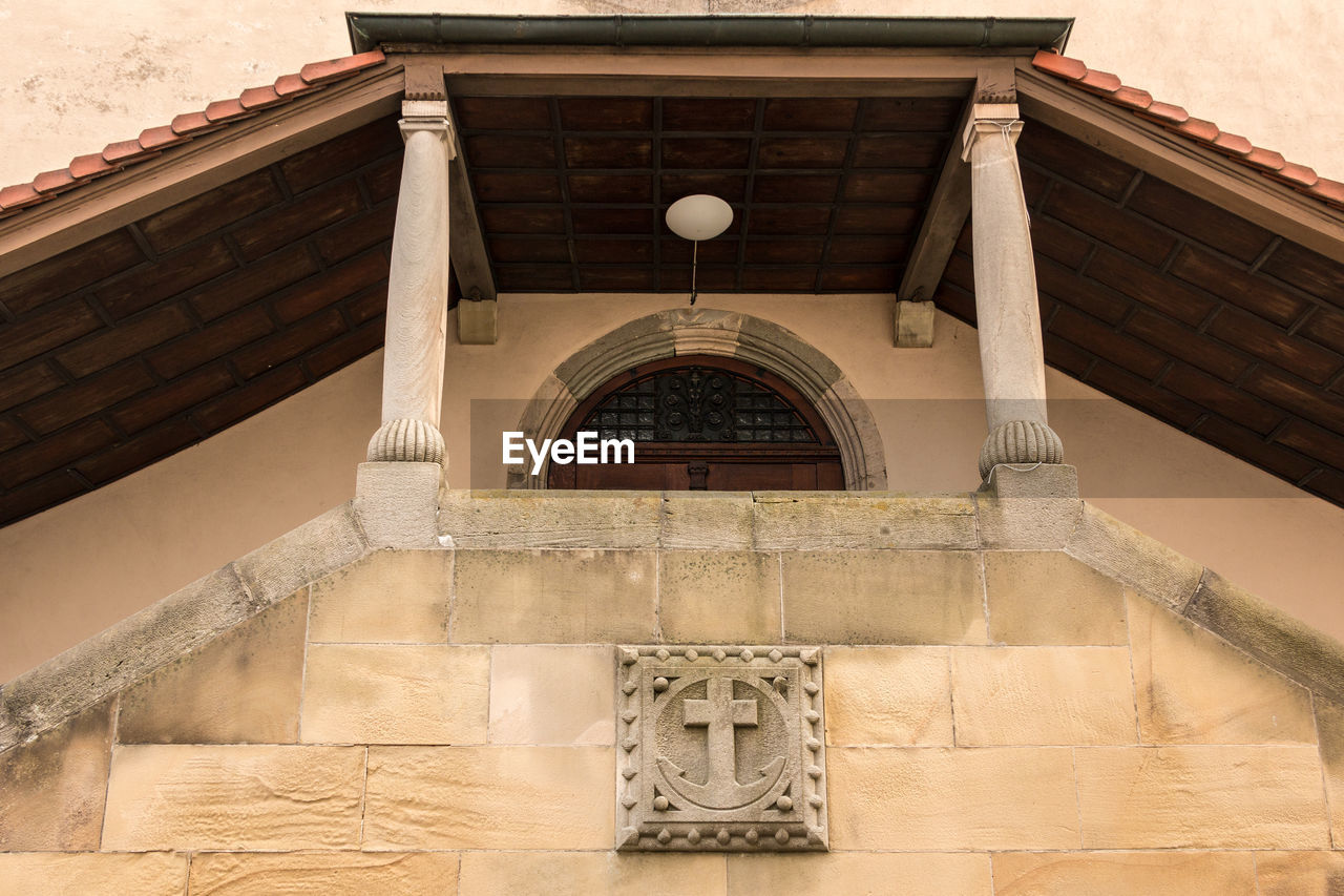 architecture, built structure, building, building exterior, no people, arch, day, low angle view, the past, entrance, history, window, belief, religion, outdoors, wall, art and craft, craft, wood - material, door
