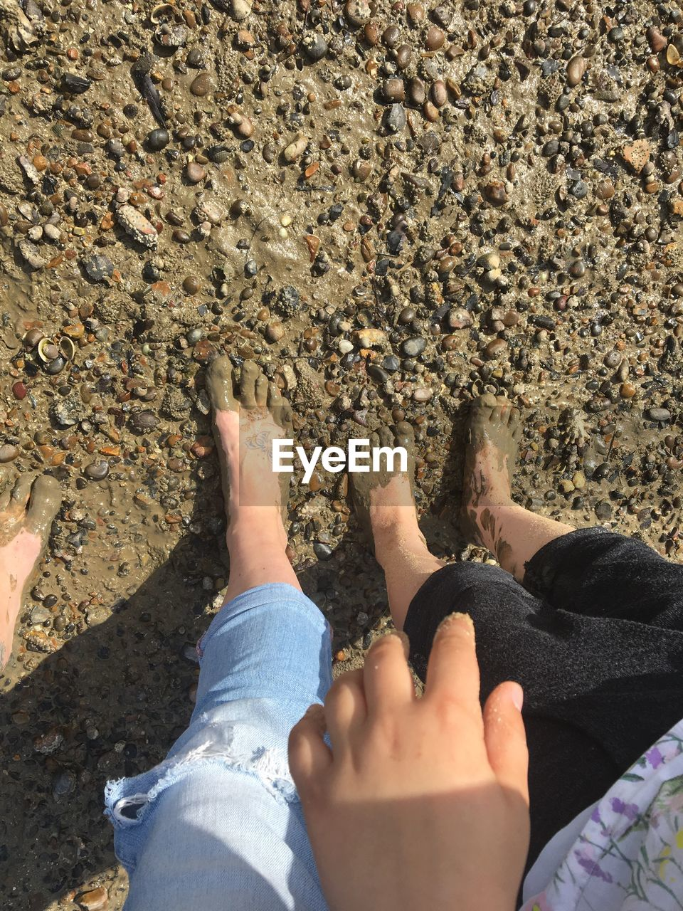 low section, body part, human body part, real people, human leg, personal perspective, high angle view, day, leisure activity, lifestyles, nature, barefoot, land, sunlight, beach, unrecognizable person, outdoors, human foot, hand, finger, pebble, gravel