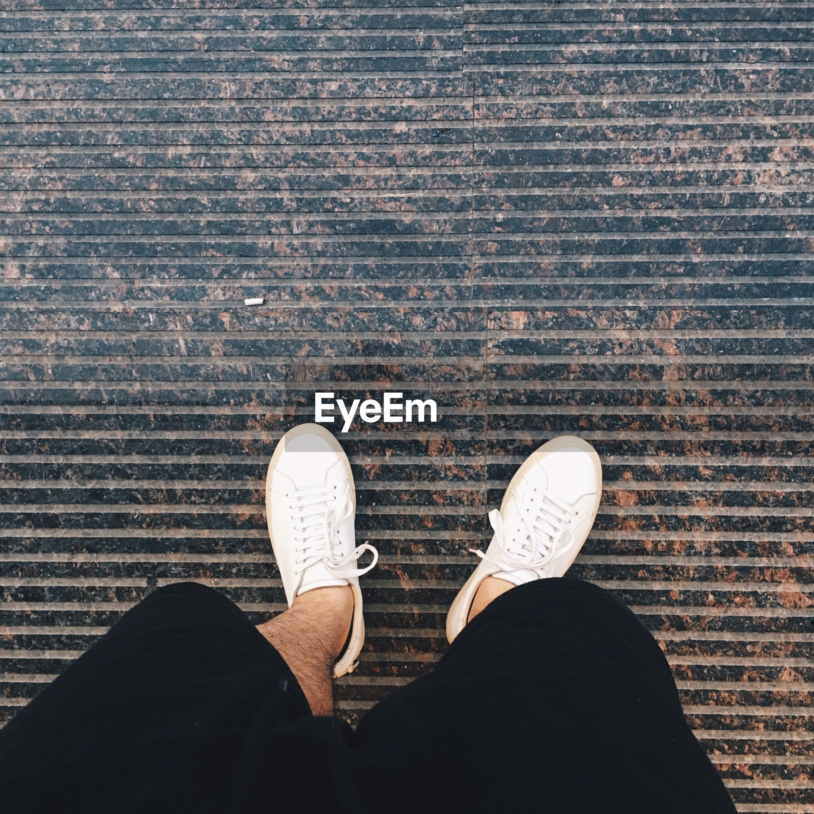 low section, person, personal perspective, shoe, standing, footwear, lifestyles, human foot, men, directly above, high angle view, leisure activity, jeans, unrecognizable person, part of, canvas shoe