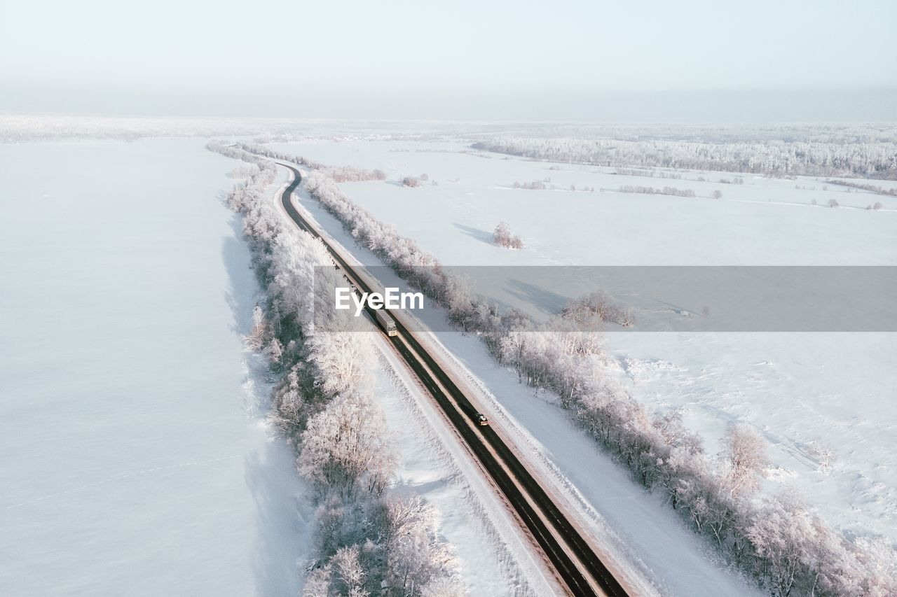 winter, snow, cold temperature, water, scenics - nature, beauty in nature, nature, sky, motion, day, no people, white color, transportation, outdoors, frozen, speed, covering, high angle view, flowing water