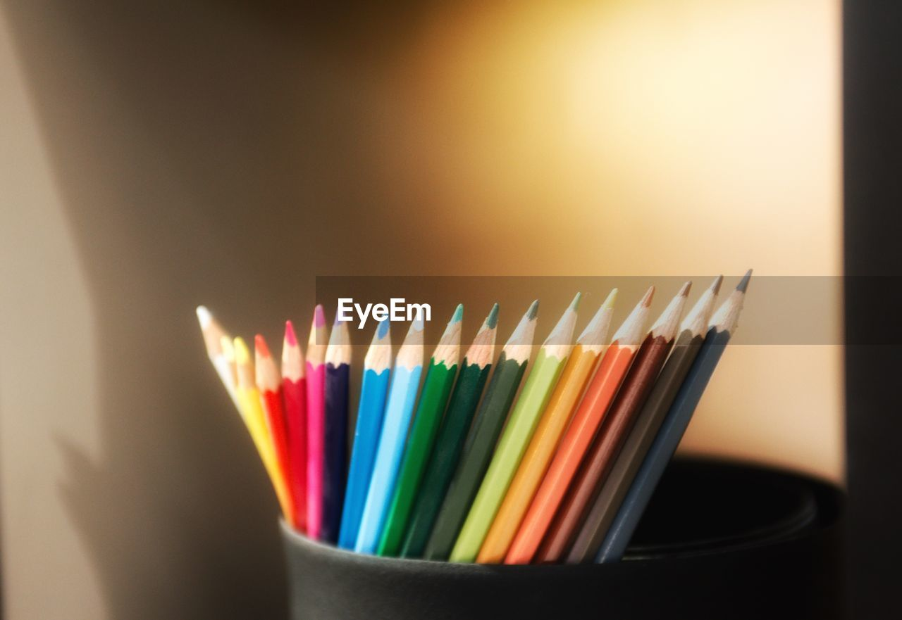 multi colored, indoors, pencil, large group of objects, close-up, still life, no people, art and craft, colored pencil, writing instrument, focus on foreground, table, creativity, choice, variation, craft, wood - material, selective focus, order, arrangement, art and craft equipment