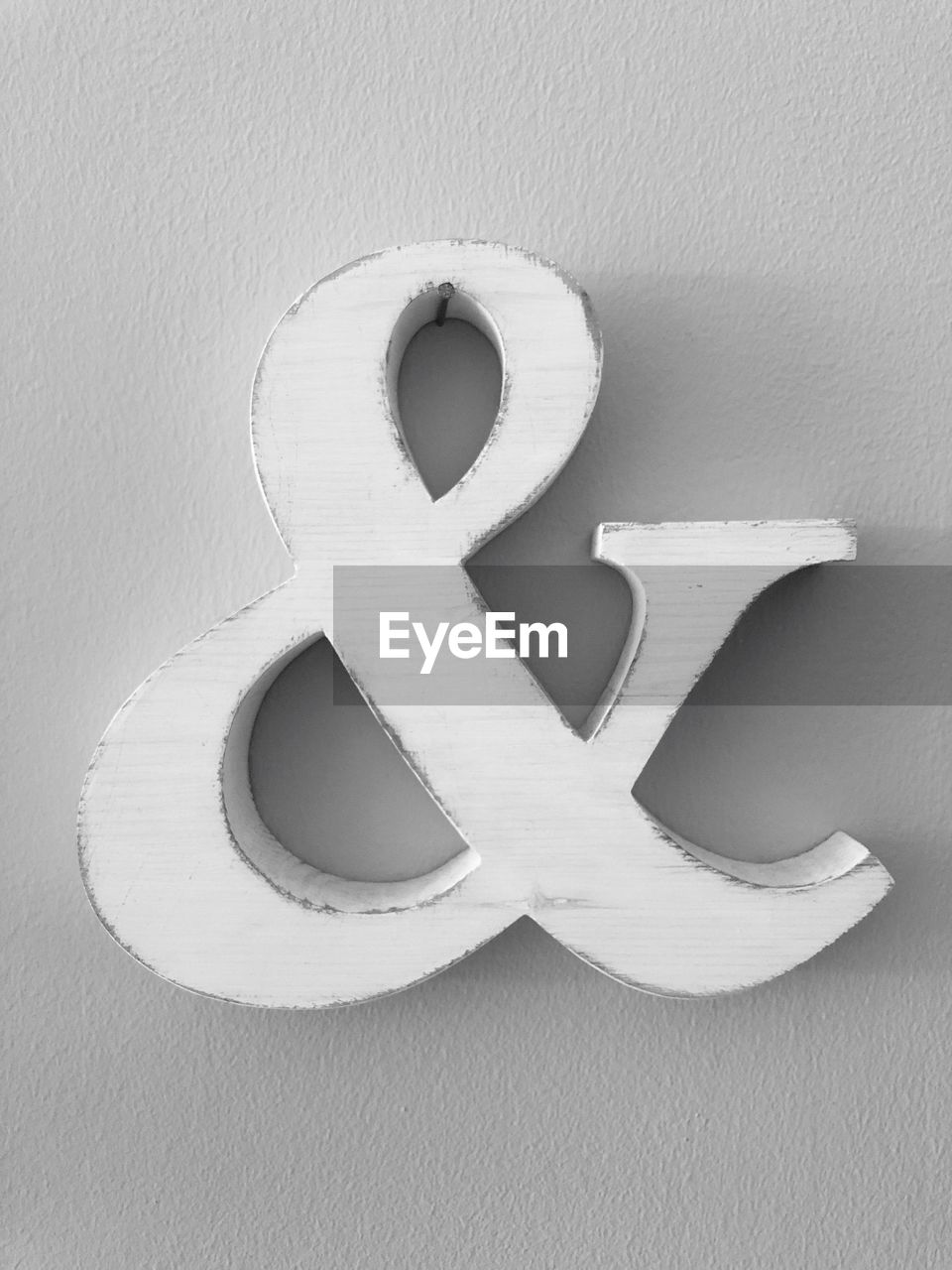 wall - building feature, indoors, no people, close-up, still life, white color, shape, creativity, art and craft, alphabet, wood - material, letter, communication, design, day, white, pattern, built structure, directly above