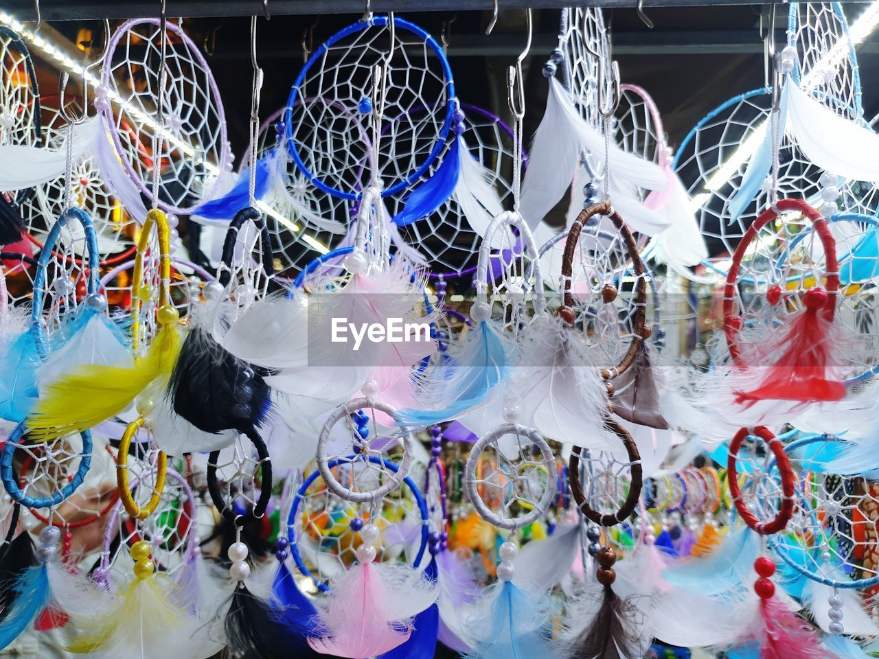large group of objects, indoors, retail, for sale, hanging, abundance, multi colored, no people, representation, choice, sale, day, decoration, celebration, pattern, glass - material, store, full frame