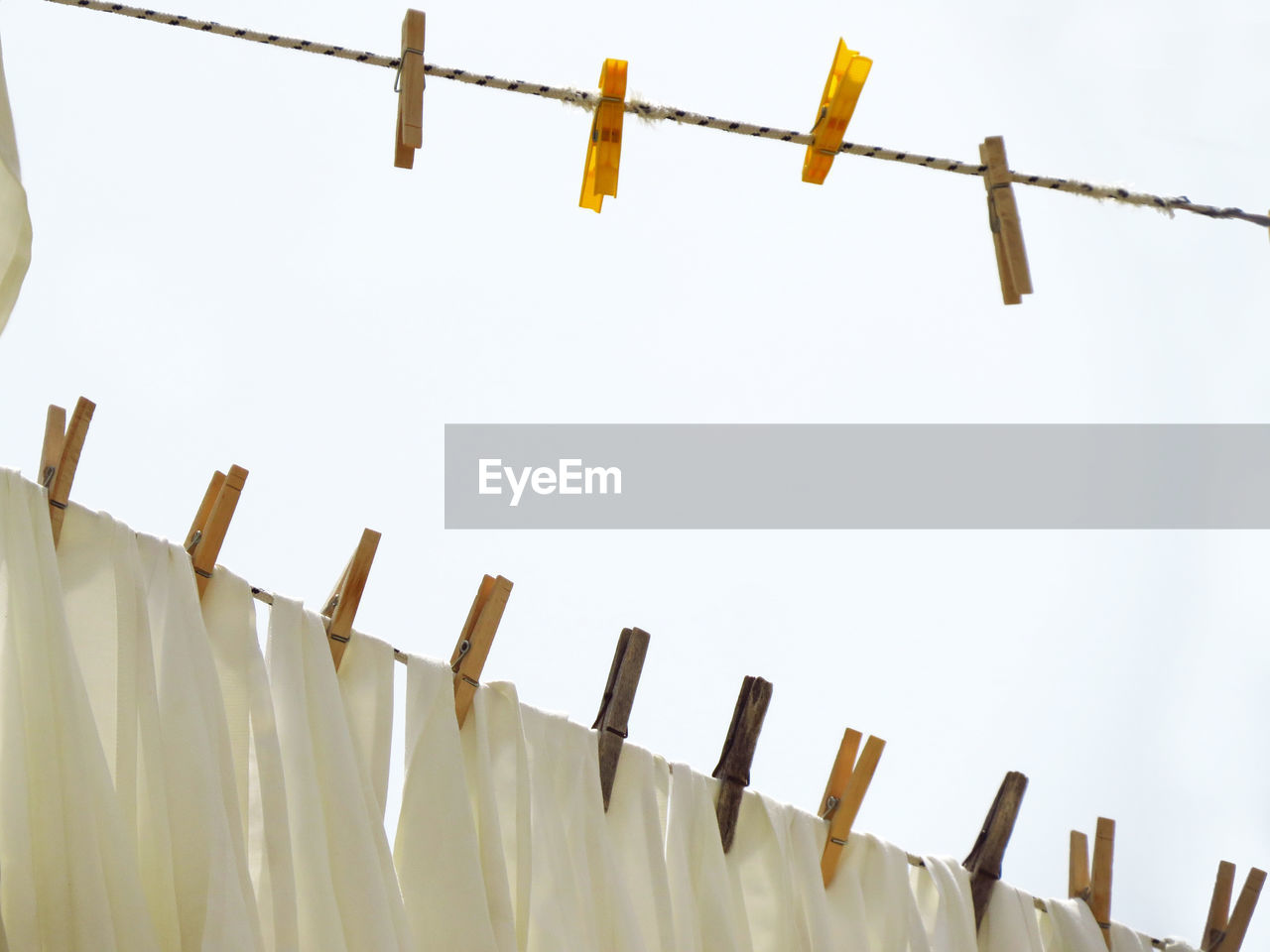 Low Angle View Of Clotheslines Against Clear Sky