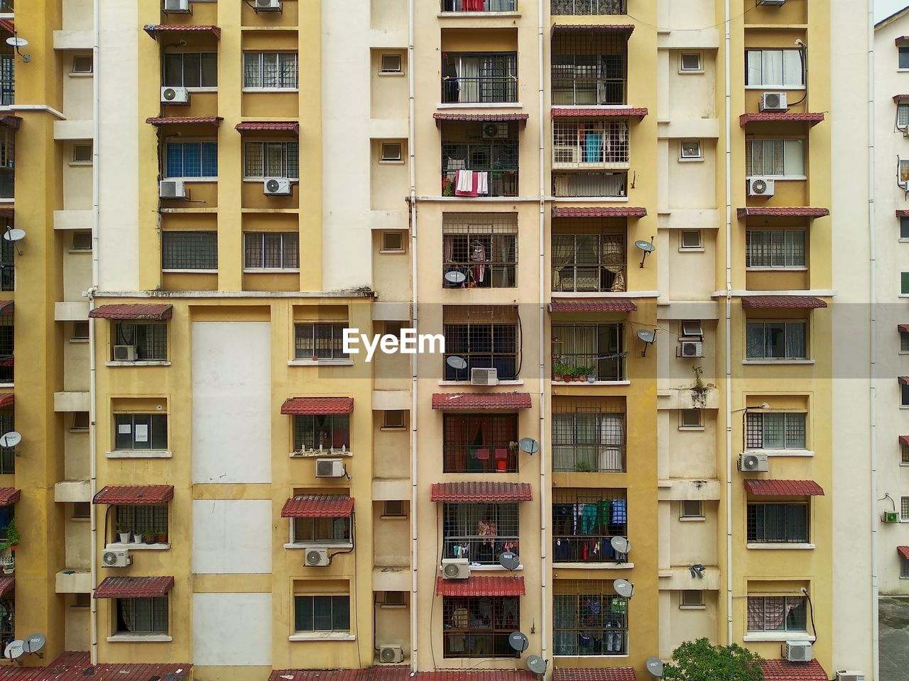 window, architecture, built structure, yellow, building exterior, no people, building, residential district, full frame, apartment, backgrounds, day, outdoors, balcony, city, repetition, in a row, pattern, nature, low angle view
