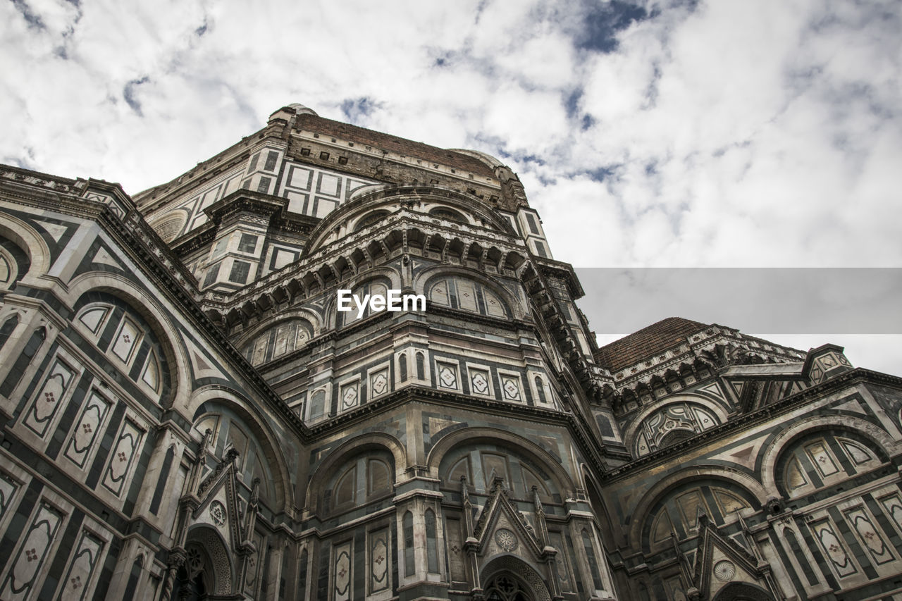 low angle view, architecture, sky, built structure, building exterior, cloud - sky, place of worship, building, belief, religion, no people, day, spirituality, history, the past, arch, nature, travel destinations, outdoors, gothic style, ornate