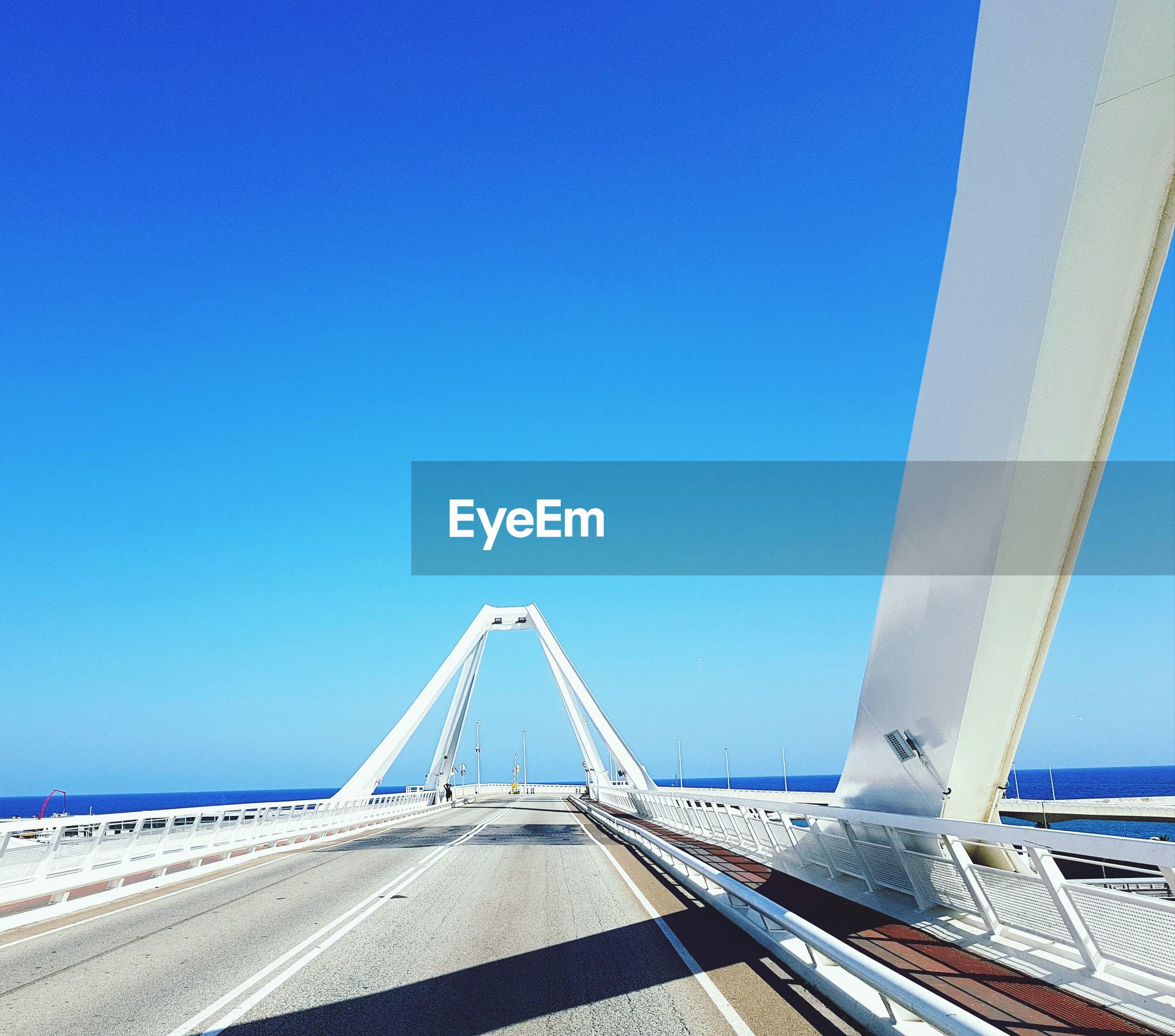 VIEW OF BRIDGE OVER CALM BLUE SEA