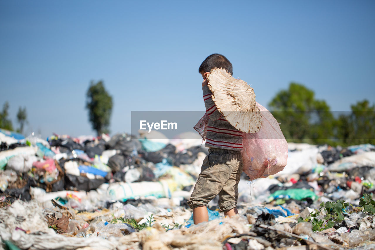 Poor children collect garbage for sale because of poverty, junk recycle, child labor.