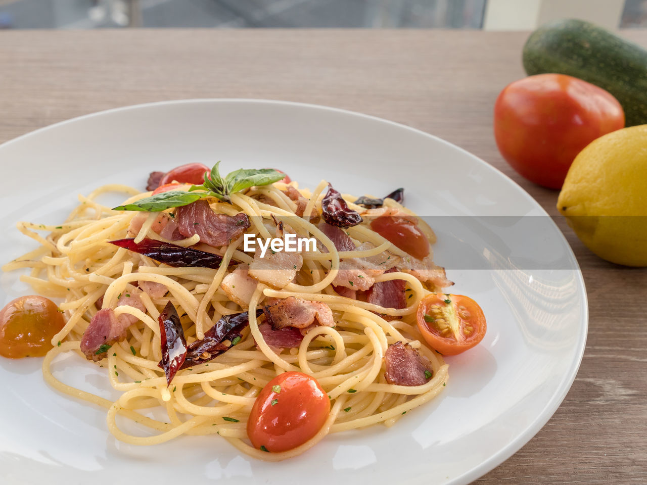 food and drink, food, pasta, freshness, italian food, healthy eating, fruit, plate, tomato, table, ready-to-eat, still life, wellbeing, serving size, vegetable, spaghetti, indoors, close-up, no people, meal, herb, garnish, temptation, crockery