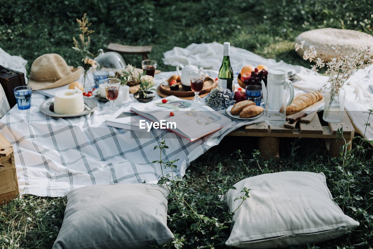 High angle view of food and drink with decorations on table in yard