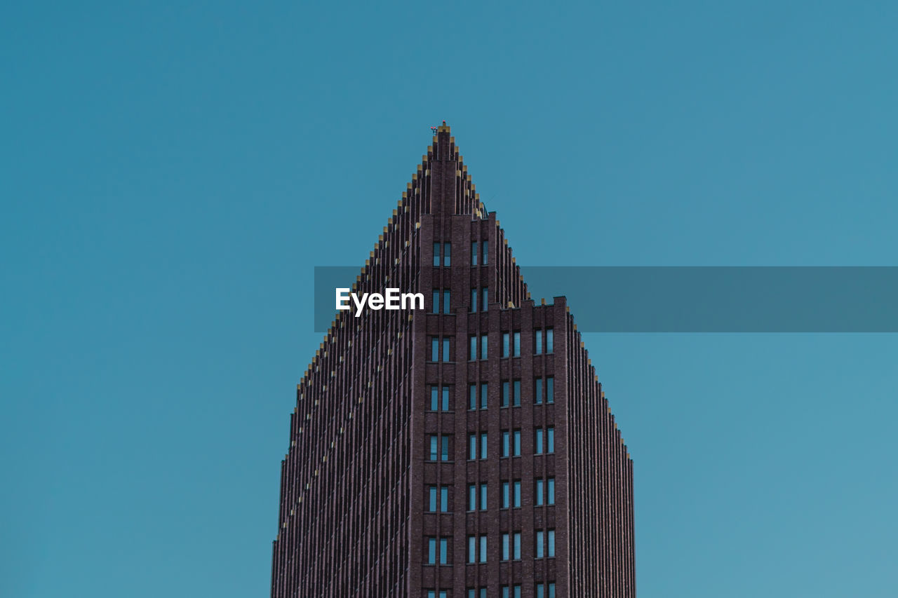 architecture, low angle view, clear sky, tower, blue, copy space, building exterior, built structure, day, no people, outdoors, skyscraper, sky