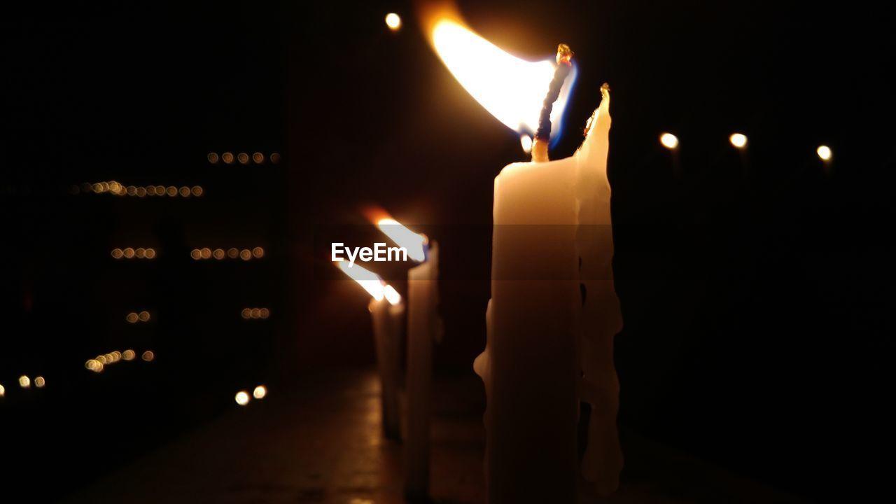 flame, fire - natural phenomenon, candle, burning, heat - temperature, glowing, illuminated, lit, lighting equipment, darkroom, night, indoors, tea light, melting, no people, close-up, focus on foreground, oil lamp, diya - oil lamp