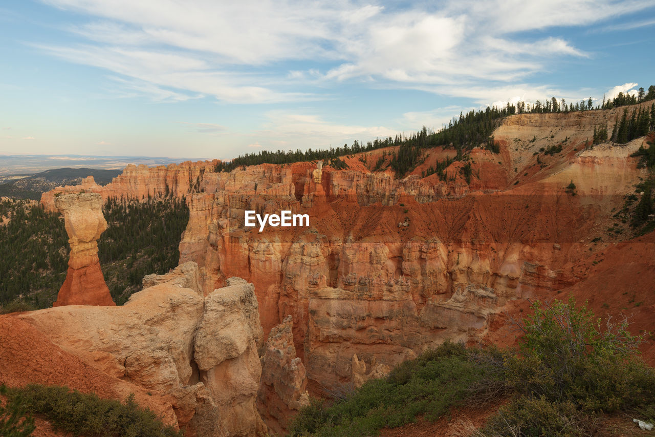 sky, cloud - sky, scenics - nature, tranquil scene, non-urban scene, beauty in nature, tranquility, rock, nature, landscape, environment, travel, travel destinations, rock formation, rock - object, mountain, physical geography, no people, solid, tourism, eroded, formation