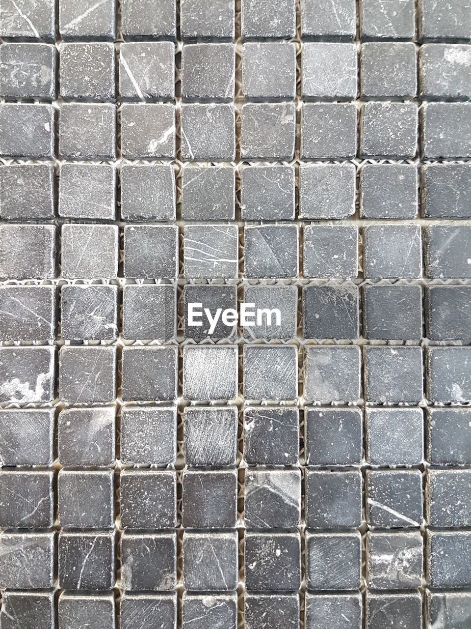 full frame, backgrounds, textured, pattern, no people, built structure, wall - building feature, day, wall, brick, architecture, brick wall, close-up, flooring, outdoors, tile, repetition, footpath, paving stone, white color