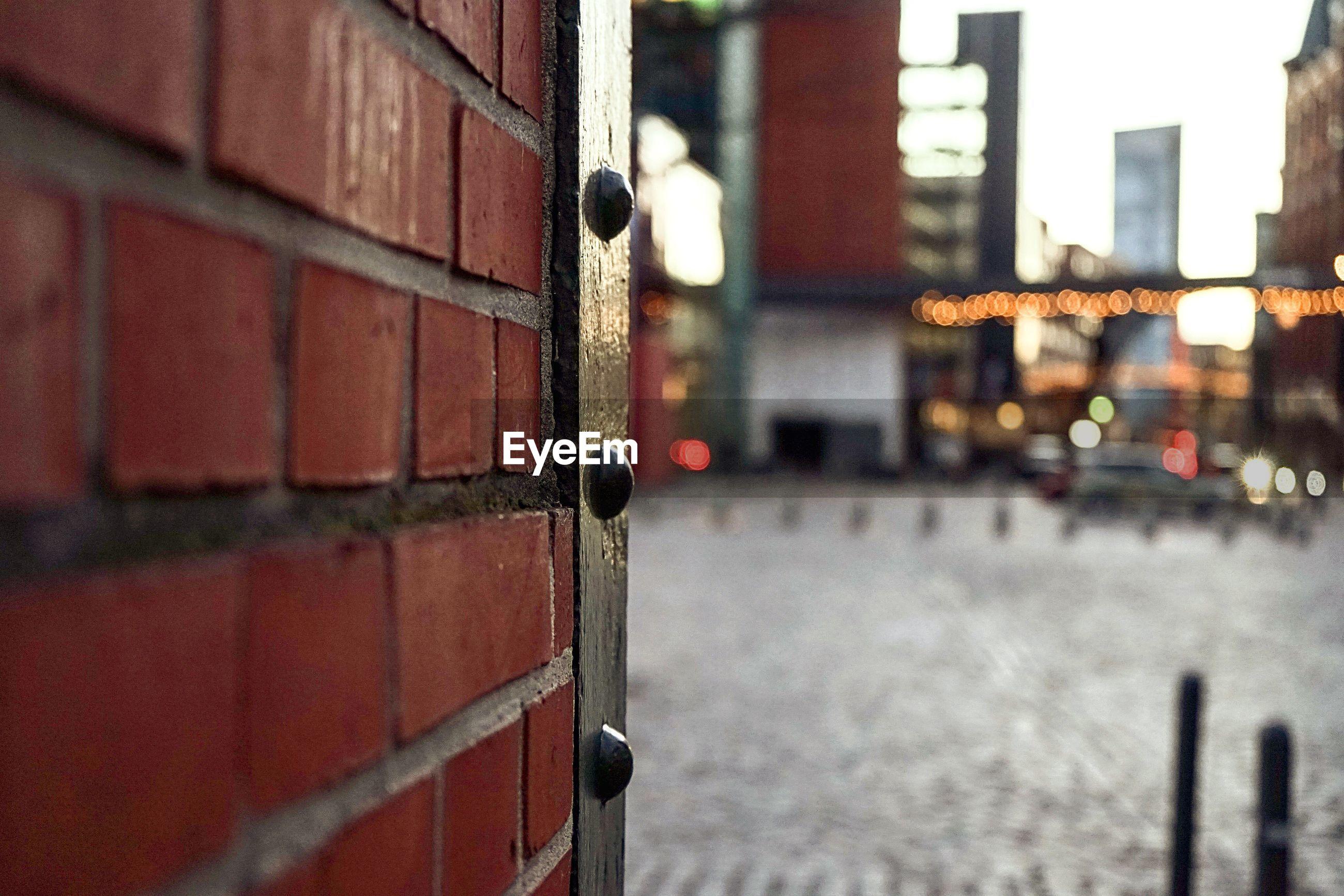 Close up of brick wall by walkway