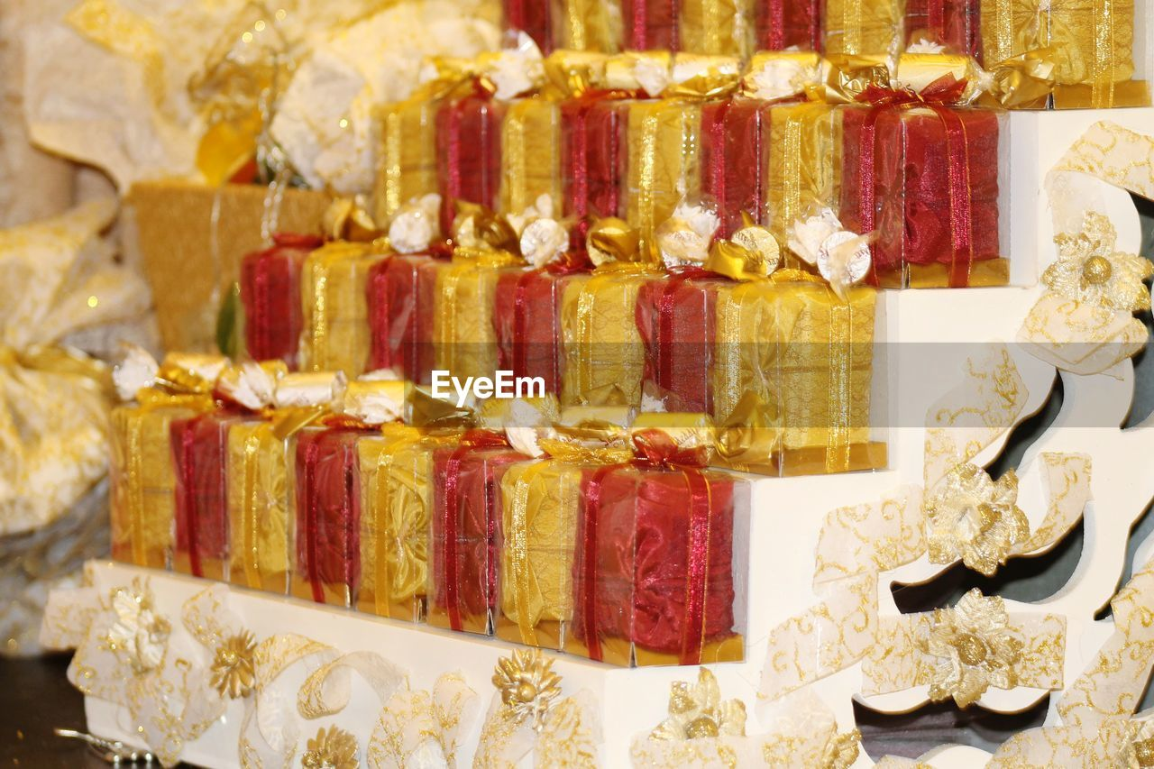 variation, choice, large group of objects, multi colored, no people, indoors, food and drink, food, red, abundance, in a row, close-up, sweet food, still life, order, freshness, jewelry, gold colored, retail, market, luxury