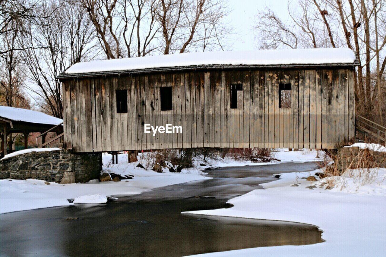 Snow Covered Bridge Over River