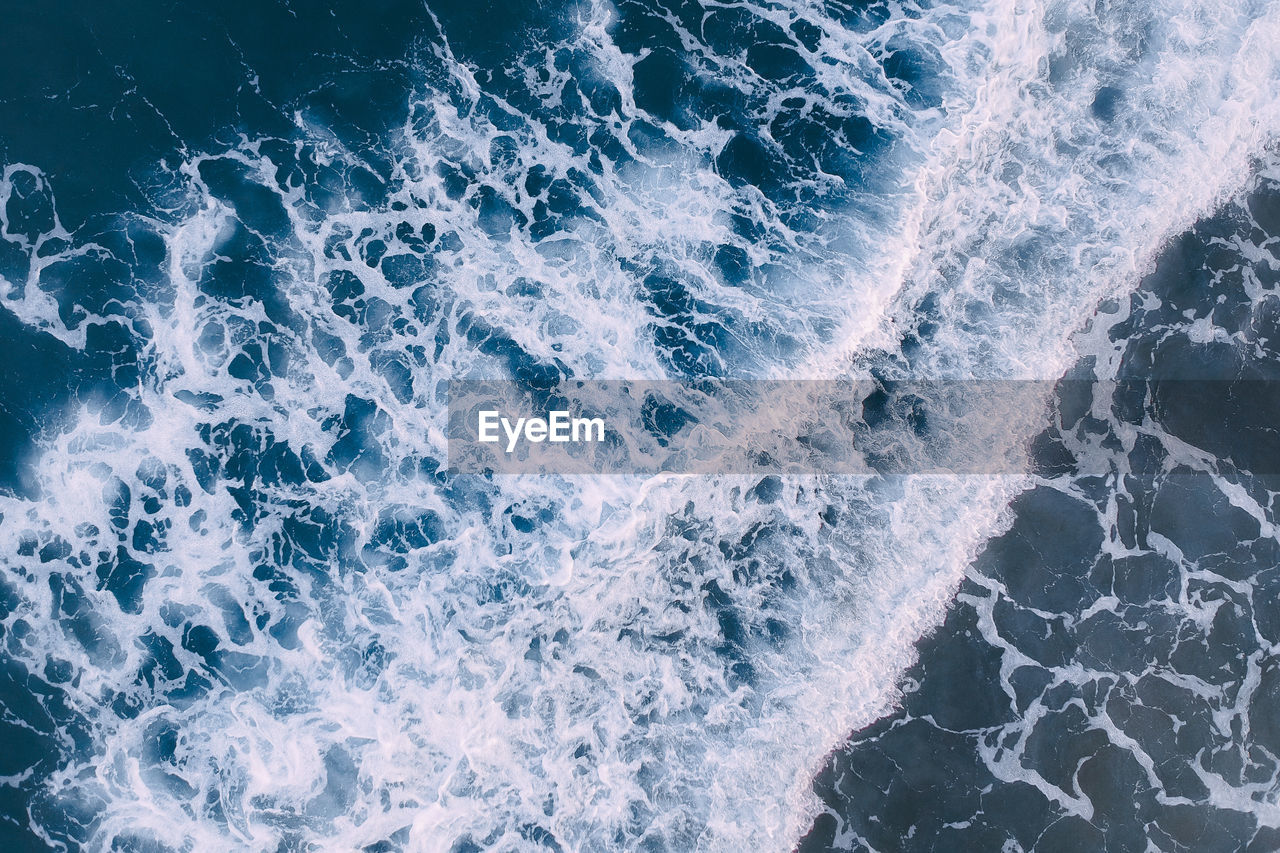 water, motion, sea, wave, sport, surfing, aquatic sport, nature, full frame, splashing, beauty in nature, high angle view, rock, power in nature, solid, rock - object, backgrounds, power, outdoors, breaking, flowing water