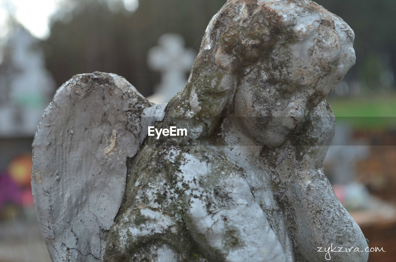 focus on foreground, cemetery, close-up, no people, statue, memorial, outdoors, sculpture, day, nature
